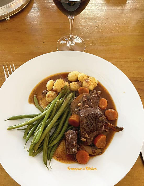 Boeuf Bourguignon served with boiled gnocchi and steam green beans