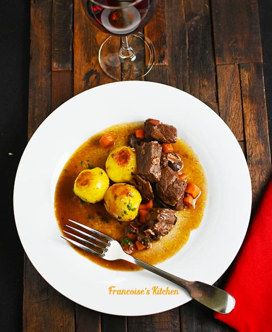 Boeuf Bourguignon served with honey gold potatoes browned in butter