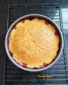 Strawberry Coconut Upside-Down Cake cooling on a rack