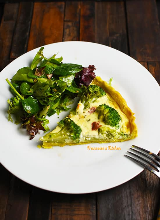 Slice of Broccoli Prosciutto Boursin Quiche served in a plate