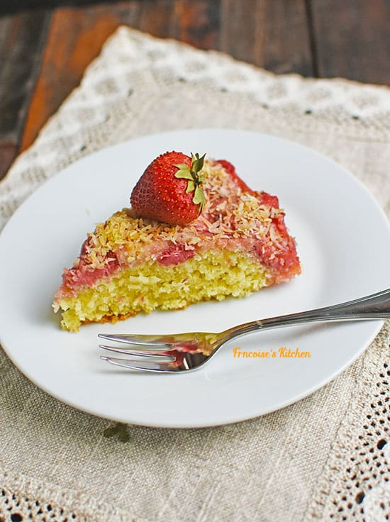 A slice of Strawberry Coconut Upside Down-Cake served in a plate