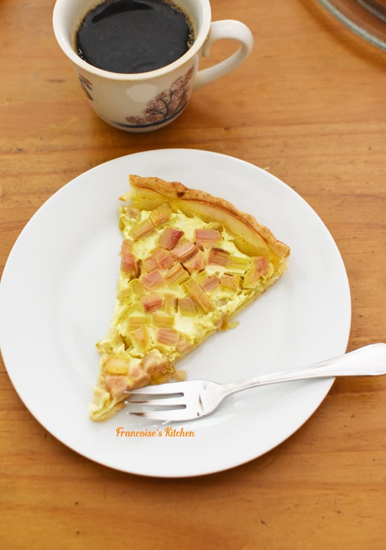 Slice of French Rhubarb Apple Tart served in a plate
