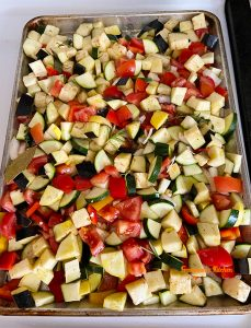 Eggplant, zucchini, bell pepper, tomatoes cubed and ready to be baked in the oven to make a ratatouille